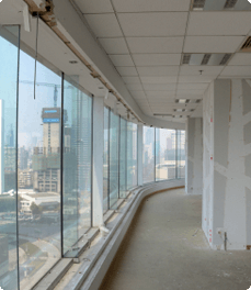 Office hallway with floor to ceiling windows